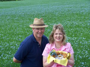 Mark & Esther Hylden in a field of bloming flax