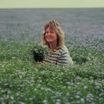 Beautiful Esther in flax field