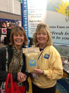 Esther at Fargo show with Facebook winner of flax bag
