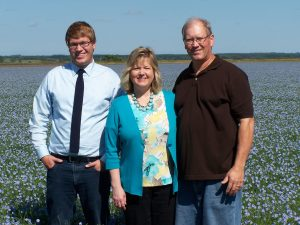 Hylden family in a field of flax